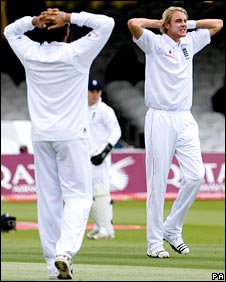 Stuart Broad (right) rues a missed catch by Andrew Strauss