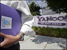 A worker walking past Yahoo headquarters