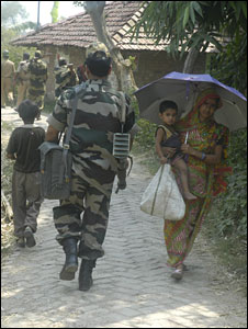 Police patrolling in a West Bengal village during village council election