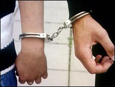 File image of man handcuffed to policeman