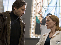 David Duchovny (Fox Mulder) and Gillian Anderson (Dana Scully)