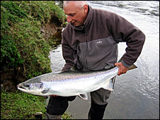 Ghillie Ernie Duff returning a salmon to the river