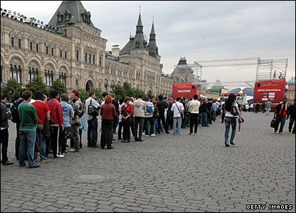 Tuesday: those fans already in red Square line up to take their picture with the Champions League trophy