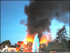 Lorry driver next to the fire