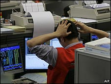 Trader contemplates share price movements on the Hang Seng index