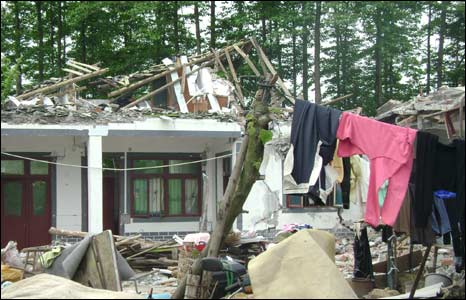 Laundry drying outside quake-hit home in Xinxing