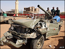 "Sudanese security forces show off fighting vehicles recently captured from Darfurian rebels following a rebel attack on Khartoum""s twin city Omdurman, on 15 May"
