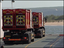 Fire engines on the chain ferry being transported across Poole Harbour