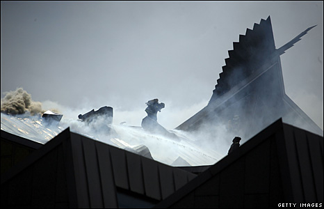 Smoke rises from the roof of the Berlin Philharmonic building, 20 May 2008