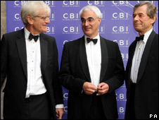 Chancellor Alistair Darling is greeted by CBI director-general Richard Lambert (L) and CBI president  Martin Broughton