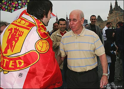 Wednesday: Sir Bobby Charlton greets Manchester United fans in Red Square