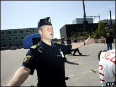 A policeman stands in front of the entrance to the Oskarshamn nuclear power plant, Sweden
