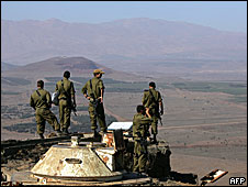 Israeli army officers looking towards Syria from the Mount Bental observation post in the Golan Heights