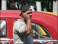 A Cuban talks by cell phone in a street in Havana