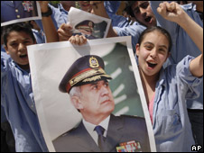School children carry pictures of Gen Michel Suleiman as they celebrate in his hometown of Aamchit, north of Beirut