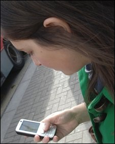 Woman watching TV on mobile