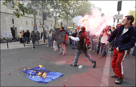 A protester throws a flare near the agriculture ministry in Paris, 21 May 2008