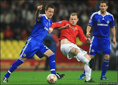 Terry and Rooney contest possession
