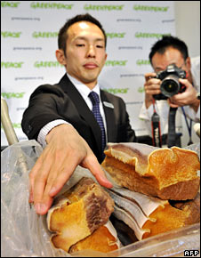 Junichi Sato with whale meat. Image: AFP/Getty