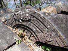 A fallen stone block, with elaborate carvings