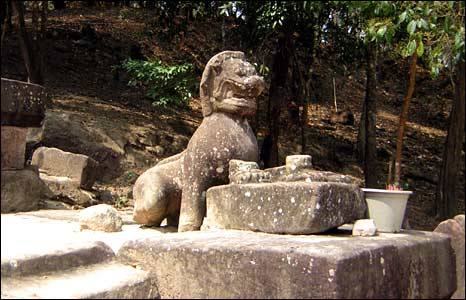 A statue on one of the stone staircases on the lower levels of the temple