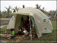 A family sit in a tent on 20 May 2008 (Image: Unicef)