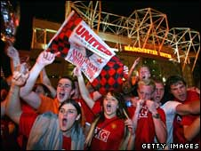 Manchester United fans celebrating outside Old Trafford