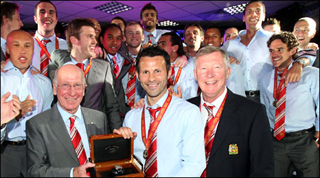 Sir Bobby Charlton and Sir Alex Ferguson present Ryan Giggs with a specially enscribed watch to mark his club record of appearances
