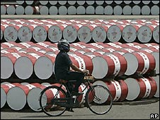 Man cycles past fuel supplies in Indonesia