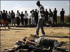 A man from Malawi lies wounded in the Reiger Park informal settlement outside Johannesburg