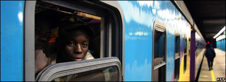 a Zimbabwean national, looks out of a South African train in Johannesburg central station on May 20, 2008 heading back to Harare as he flees the country due to the ongoing xenophobic violence in Johan