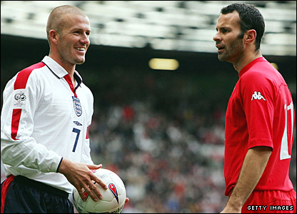 David Beckham shares a joke with Giggs at Old Trafford