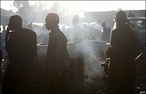 Men in temporary refugee camp at Primrose police station, Johannesburg