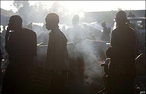 Men in temporary refugee camp at Primrose police station, Johannesburg