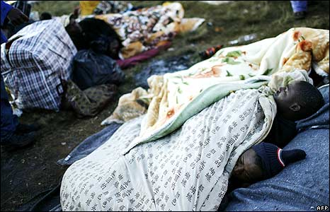 People sleeping in temporary refugee camp at Primrose police station, Johannesburg