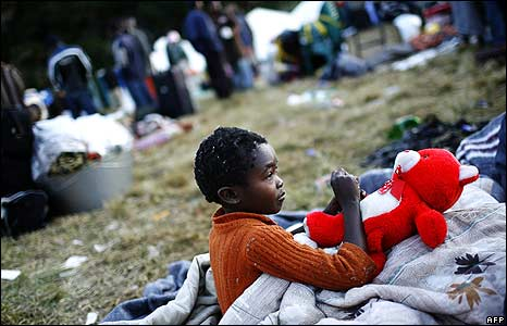Child waking up in temporary refugee camp at Primrose police station, Johannesburg 
