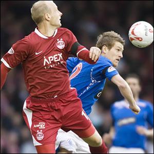 Aberdeen midfielder Stuart Duff (left) with Rangers midfielder Steven Davis