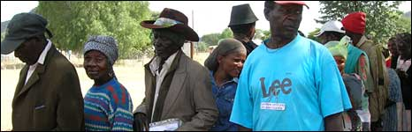 People in Otjivero, Namibia, line up to receive their monthly payment