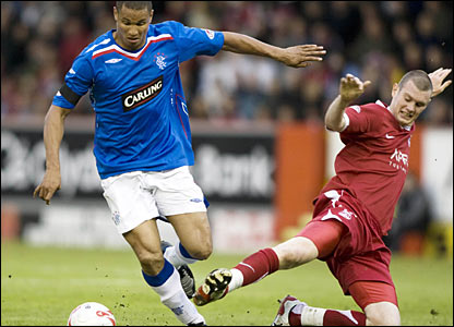 Rangers striker Daniel Cousin (left) and Dons defender Zander Diamond