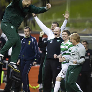 Neil Lennon (left) jumps for joy