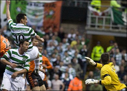 Celtic striker Jan Vennegoor of Hesselink (10) scores the opening goal