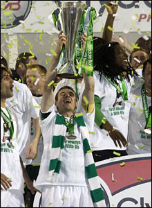 Celtic captain Stephen McManus holds the SPL trophy aloft