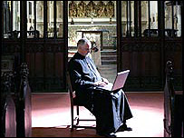 Reverend Kimber surfs the web wireless in his church