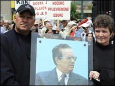 Bosnians hold a picture of Josep Broz Tito