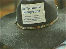 Anti-Islamic immigration slogan on protester's hat, May 2008