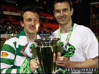 Stephen McManus and Lee Naylor hold the Scottish Premier League trophy