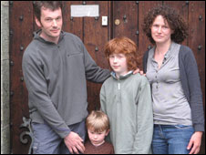 Karl, Fred, Owen and Natalie Meredith outside their church