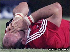 Lawrence Dallaglio covers his face as he lies in agony after injuring his ankle while playing for the Lions in 2005