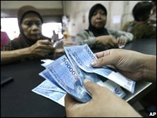Women cash in fuel compensation coupons in Jakarta