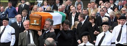 Martin McGuinness and Gerry Adams carry Brian Keenan's coffin